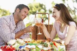 couple sharing glasses of wine enjoying their holiday